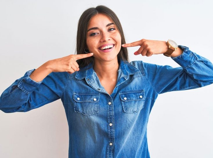 woman-smiling-pointing.jpg